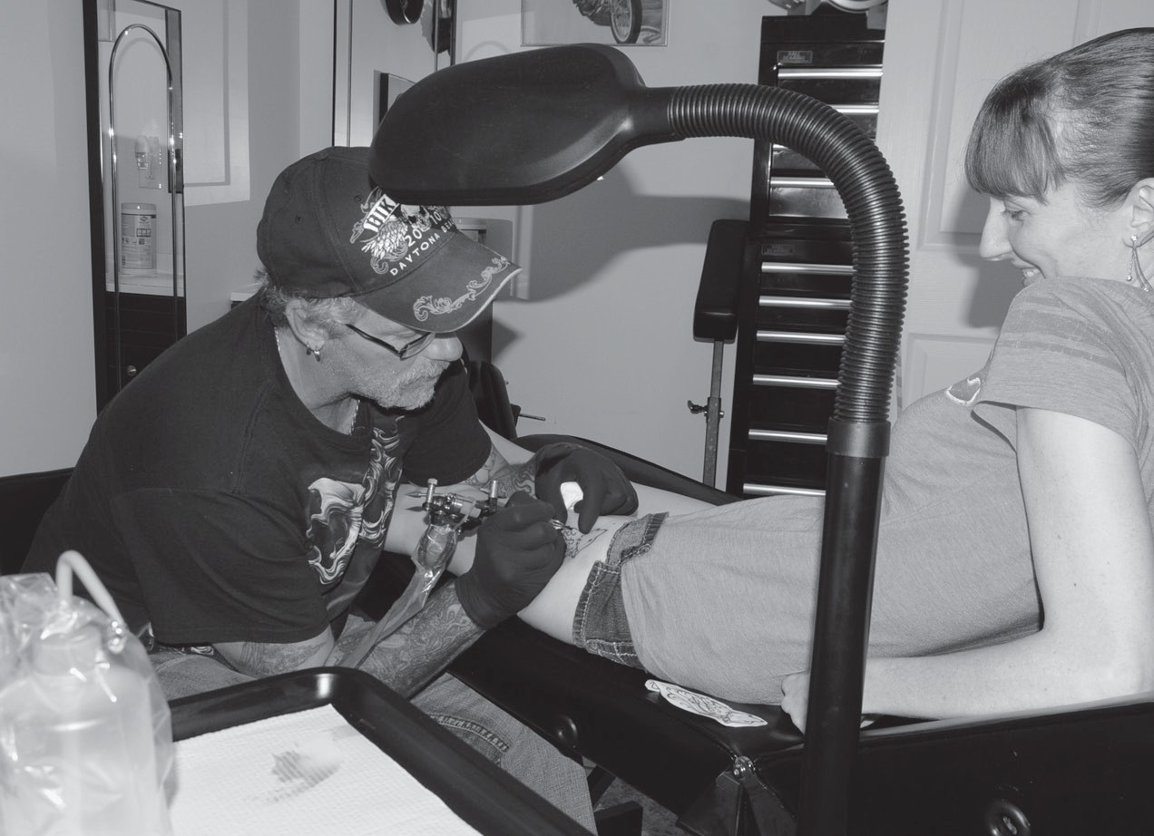 """bbbba5d93 Since opening on Memorial Day, Dark Horse Tattoo Studio owner Pat Bridges  said his business is doing """"awesome,"""" as he has completed 63 tattoos in  just over ..."""